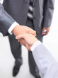 handshake of business partners after signing