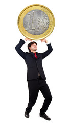 Businessman lifting up a giant euro coin