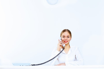 Young woman with a phone in office