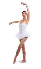 Portrait of  ballet dancer in tutu over white