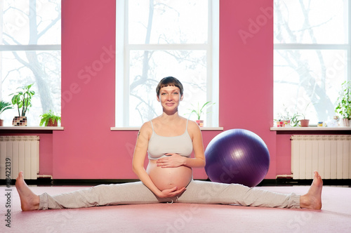 Young pregnant woman doing pregnancy yoga