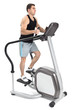 one man doing step machine exercise