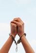Hands handcuffed
