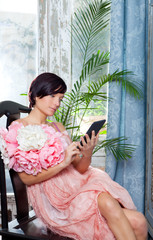 fashion woman and tablet ebook reading with flowers dress
