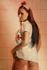 Very sexy nude woman in kinky nurse uniform