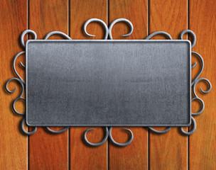 Vintage metal plate  on old oak door