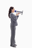 Profile of a businesswoman speaking loudly in a megaphone