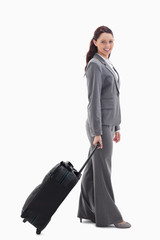 Profile of a businesswoman smiling with a suitcase