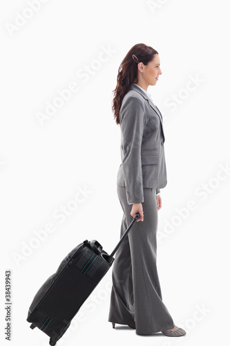 Profile of a businesswoman with a suitcase