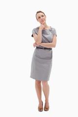 Thoughtful woman posing in dress