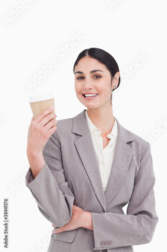 Smiling businesswoman with coffee in a paper cup