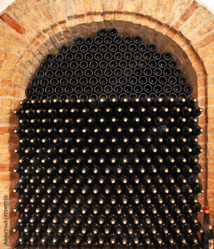 Fototapeta Bottles of wine in cellar.
