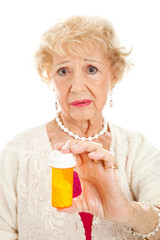 Sad Senior Woman with Pills