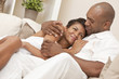 Happy African American Man & Woman Couple Embracing