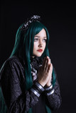 girl cosplay anime character pray in dark poster