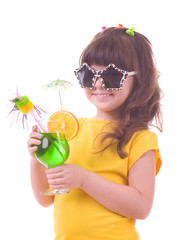 Beautiful little girl drinking green child's cocktail