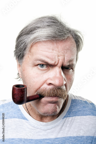gloomy mature man with smocking pipe isolated on white
