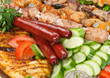 Grilled sausage with sauce and vegetables