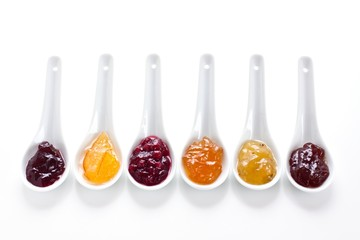 Fruit jams in china spoons