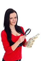Woman with money and magnifying glass