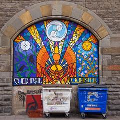 Graffiti behind the bins in inner city Bristol