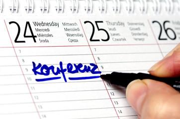 Kalender mit Eintrag Konferenz