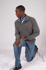black man in grey sweater, looking thoughtfully