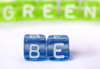 Text Be green on colorful cubes