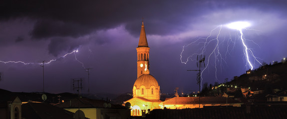 Lightning over Alba and surrounding hills in Italy.