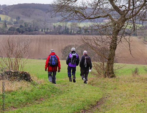 Three male Ramblers on an English Rural Trail