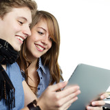 Fototapety Young couple surfing on the internet with touchpad
