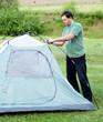 A man puts a tent