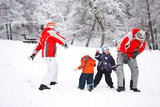 Family having fun in snow