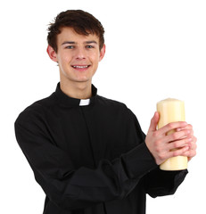 A priest with a candle