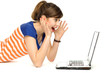 Surprised young woman using laptop