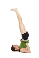 woman doing shoulder stand
