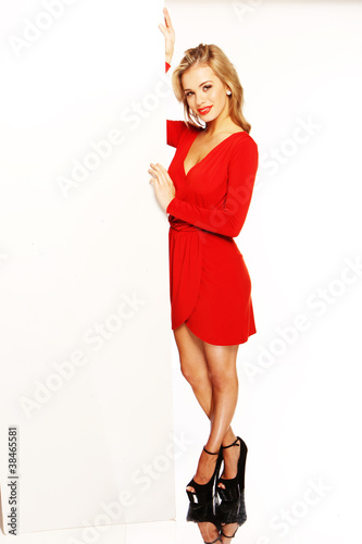 Attractive Blonde Holding Vertical Blank Card