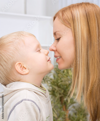mother and son about to kiss
