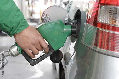 Refueling Automobile With Gasoline Pump Nozzle