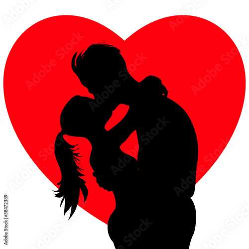 Young passionate kissing couple silhouettes