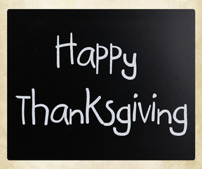"""Happy Thanksgiving"" handwritten with white chalk on a blackboar"
