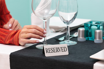 Woman at reserved table