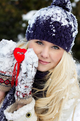 Happy winter girl with the red heart