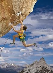 Rock climber dangling.