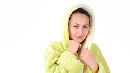 A young girl dressed in a bathrobe - cold time