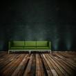 Wohndesign - grünes Sofa vor schwarzen Wand