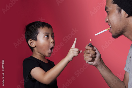 Boy asking a smoker to stop smoking
