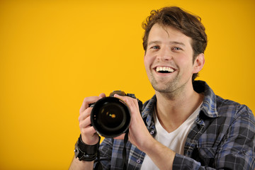 happy photographer with SLR camera