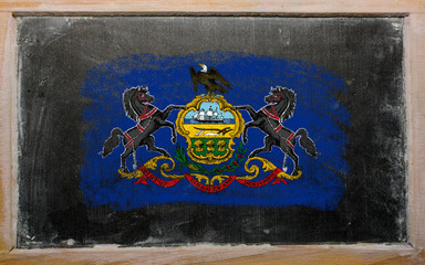 flag of US state of pennsylvania on blackboard painted with chal