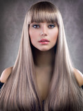 Beautiful Girl with Blond Hair. Healthy Long Hair